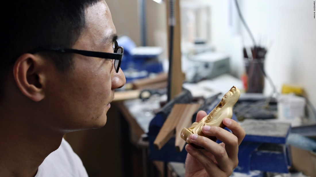 With demand for ivory carving falling, Li Jiulong, the older Li's student,  is undertaking a master's degree which sees him working with lacquer -- a traditional colored finish applied to wood.<br />