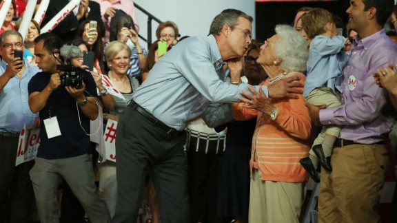 Former Florida Gov. Jeb Bush kisses his mother Barbara Bush as he is introduced to announce his candidacy for the Republican presidential nomination during an event at Miami-Dade College - Kendall Campus on June 15 , 2015 in Miami, Florida.