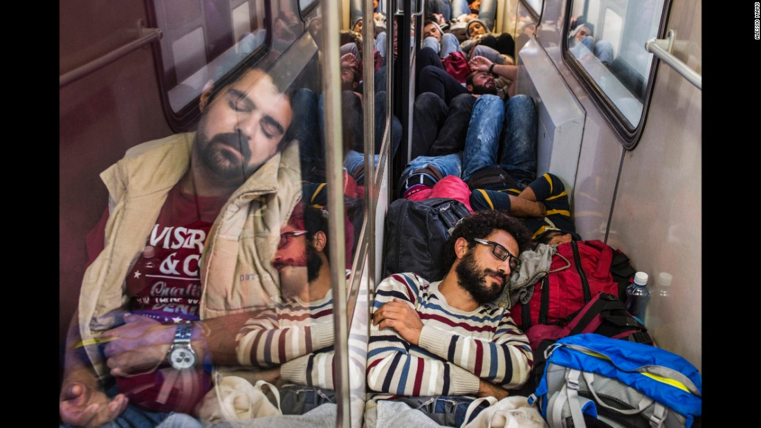 Somar, bottom right, rests during a train ride to Serbia. Italian photographer Alessio Mamo documented Somar and his two sisters as they traveled through numerous countries to Germany.