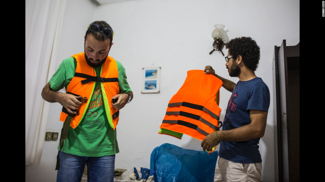 Somar and a friend, Ali, buy life jackets in Turkey before crossing the sea into Greece. The family paid a smuggler 1,000 euros each ($1,100 U.S.) to get them into the country.