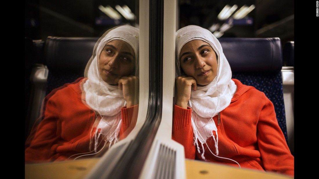 Lubna cries on a train. Only in Germany do Somar's sisters realize they might never return to Syria.