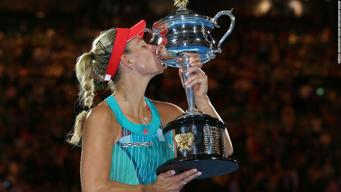 Angelique Kerber of Germany kisses the Daphne Akhurst Trophy after winning the Australian Open women's singles title in a stunning upset of Serena Williams in Melbourne.
