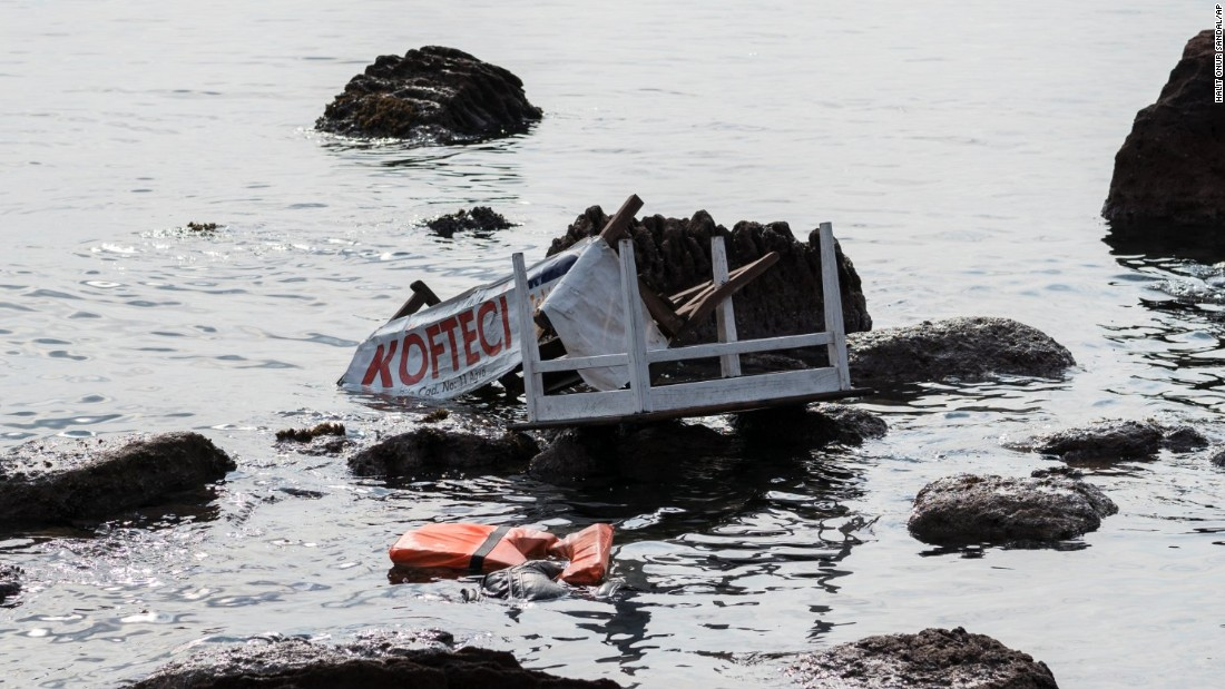 The remains of a boat that was carrying migrants are seen on the shoreline near the Aegean town of Ayvacik, Canakkale, Turkey, Saturday, January 30. At least 33 migrants died after the boat capsized in the Aegean Sea.