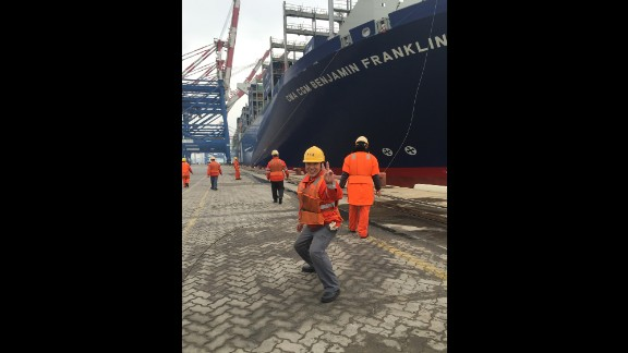 "CHINA: ""Chinese longshoremen berthing a monster container ship the 'Benjamin Franklin'. She carries close to 18000 containers. If you laid that many out end to end it would stretch 68 miles, about 100 km. It's loading up with stuff in the Port of Xiamen and will head to Los Angles. It will be the biggest container ship to dock in the US."" - CNN's Brad Olson @cnnbrad, January 30."