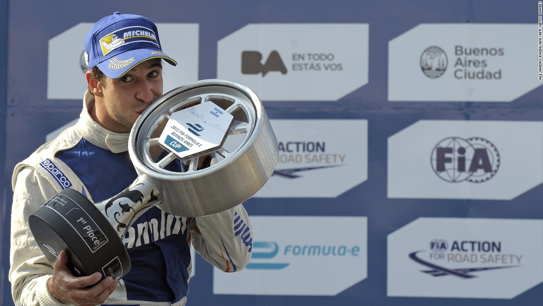Team Aguri's Portuguese driver Antonio Felix da Costa gets passionate with the trophy after winning the inaugural race in 2015.