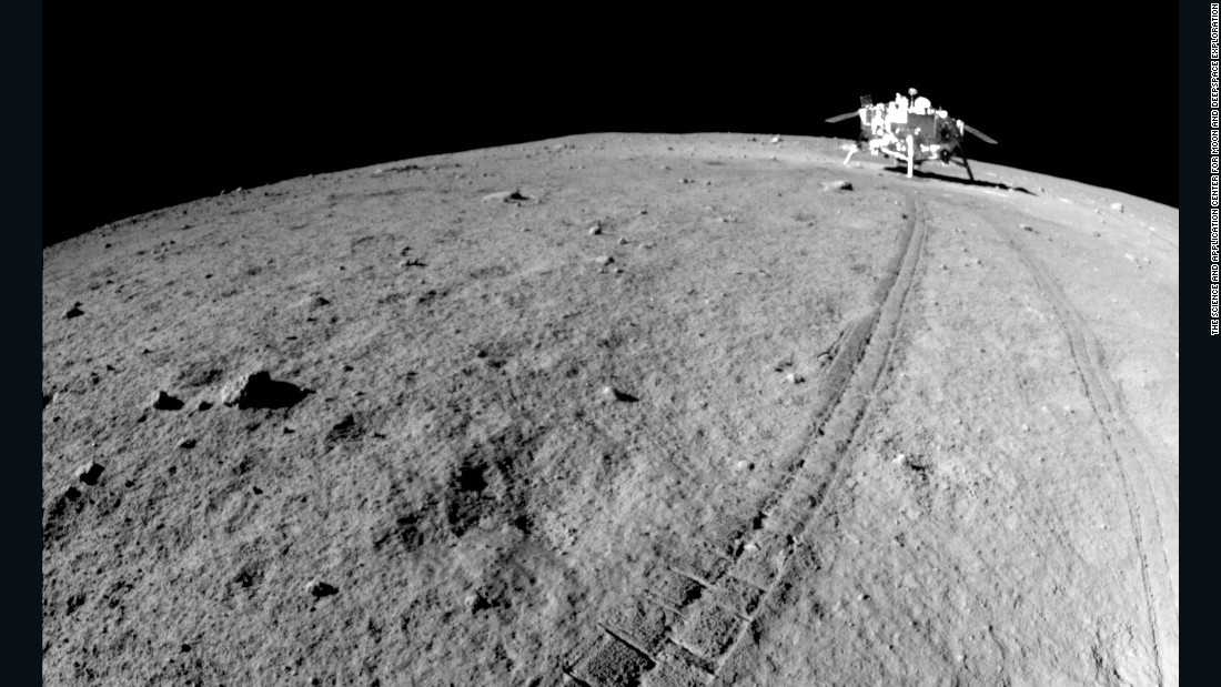 The tracks of the Jade Rabbit lunar rover, with the Chang'e 3 spacecraft in the background.