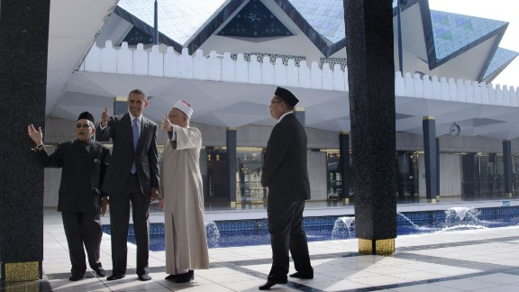 In Malaysia, President Barack Obama (second from left) receives a tour of the National Mosque in Kuala Lumpur on April 27, 2014. Obama paid homage to Malaysia's moderate brand of Islam and visited the mosque during an Asian trip.