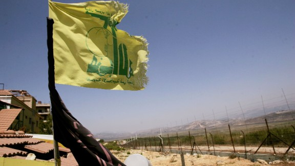 A Hezbollah flag in Lebanon, near a fence on the Israeli-Lebanese border 10 years ago.