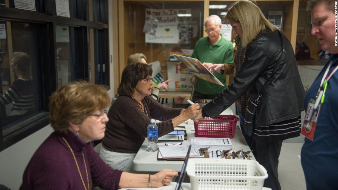 Caucus workers check in voters prior to a Republican Party caucus in Keokuk.