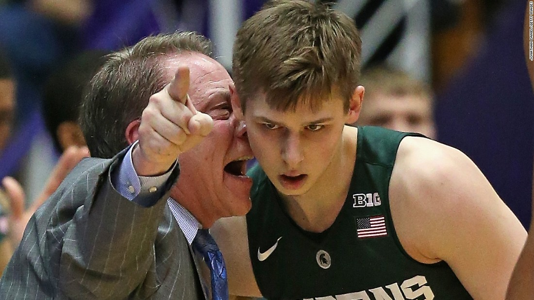 Michigan State basketball coach Tom Izzo gives instructions to Matt McQuaid during a game at Northwestern on Thursday, January 28.