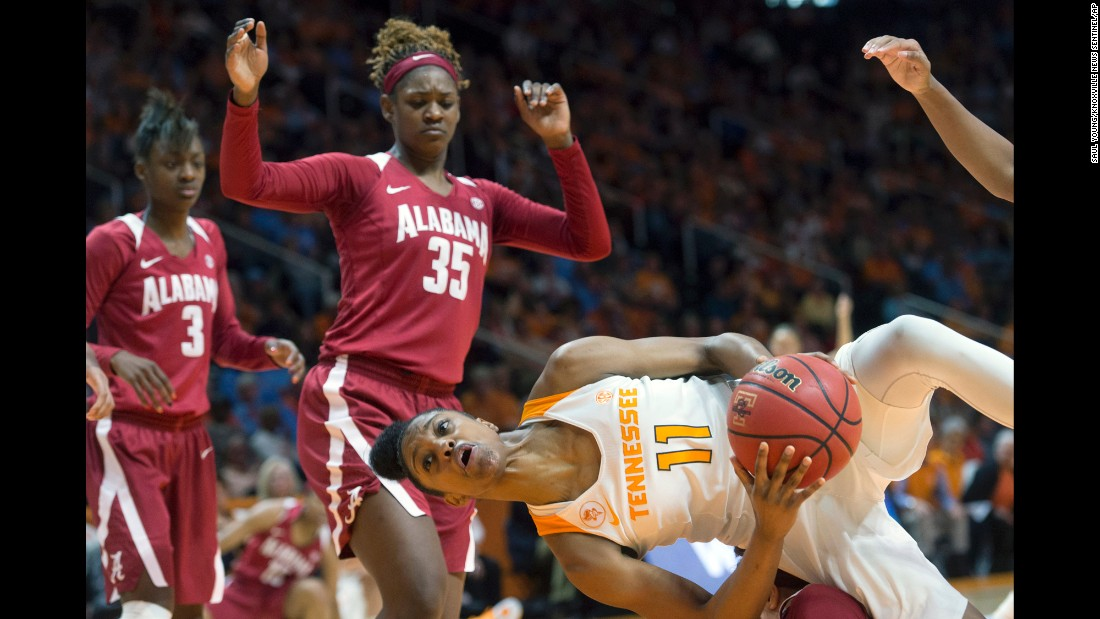 Tennessee's Diamond DeShields goes horizontal after colliding with an Alabama player (off camera) in Knoxville, Tennessee, on Sunday, January 31.
