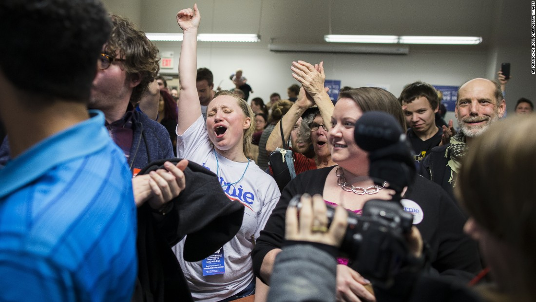 A Sanders supporter celebrates caucus results at a Des Moines precinct.