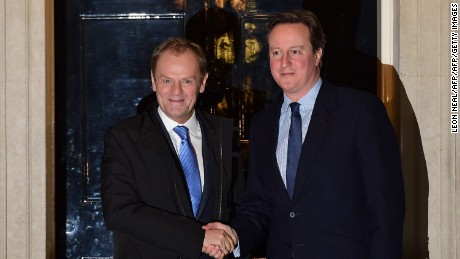 British Prime Minister David Cameron, right, greets European Council President Donald Tusk outside 10 Downing Street in London on Sunday night.