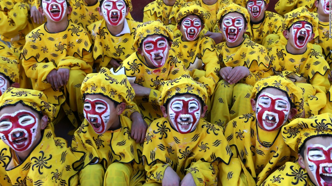 Children dressed up as the Monkey King perform during an art fair in Beijing on February 1.