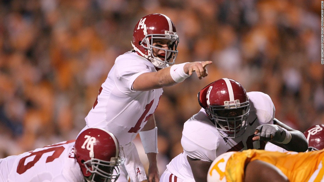 Former Alabama Crimson Tide quarterback John Parker Wilson (#14) says mental strength conditioning allowed him to focus in even the most hostile environments. He is seen pointing out the defensive alignment of the Tennessee Volunteers during an away game on October 25, 2008, when Alabama defeated Tennessee 29-9.