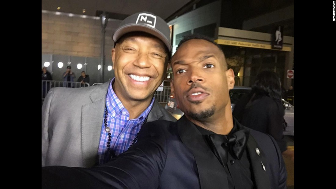 "Hip-hop mogul Russell Simmons, left, <a href=""https://www.instagram.com/p/BBDD45eujUT/"" target=""_blank"">poses with actor Marlon Wayans</a> as he attends the ""Fifty Shades of Black"" premiere on Tuesday, January 26."