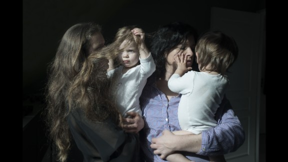 Veronique and Anne pose with their twins, Angele and Lucien, in Brest, France. The same-sex couple had to travel to Belgium to get the in-vitro fertilization they couldn't get in France, said photographer Vincent Gouriou.