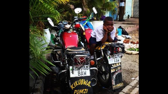 TANZANIA: A curious onlooker at Kariakoo market in Dar es Salaam. Photo by CNN's Gisella Deputato @gisellacnn.