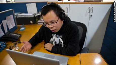 Chinese journalist Li Xin talks to an Associated Press reporter over Skype from New Delhi in November.