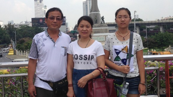 Dong Guangping, left, with his wife Gu Shuhua, and daughter in Bangkok on October 7, 2015 after handing in documents to the UNHCR.