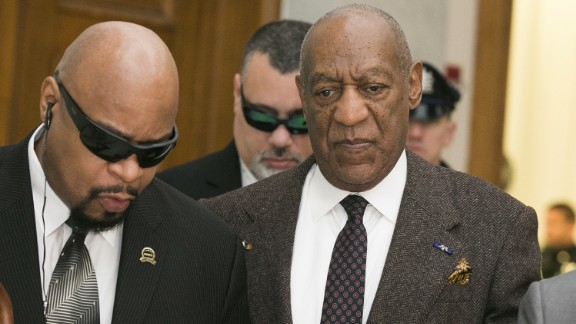 Bill Cosby, who his lawyers now say is legally blind, has been escorted into his recent court hearings on the arms of his representatives.