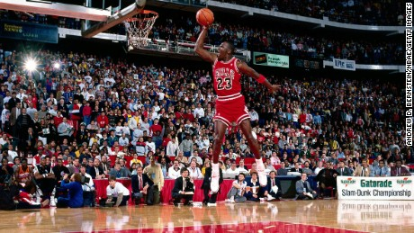 Michael Jordan #23 of the Chicago Bulls goes for a dunk during the 1988 NBA All Star Slam Dunk Competition on February 6, 1988, at Chicago Stadium in Chicago, Illinois.