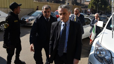 Maurizio Massari, front, the Italian ambassador to Egypt, arrives at a morgue Thursday where the body of Italian student Giulio Regeni was brought after it was found.