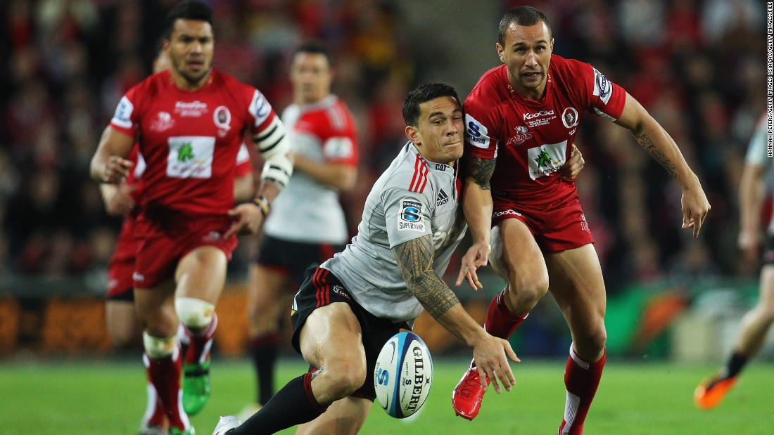 Cooper is close friends with New Zealand rugby star Sonny Bill Williams. Here they compete for the ball during the 2011 Super Rugby final between the Reds and the Crusaders.