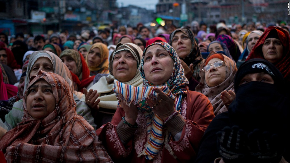 Kashmiri Muslims in Srinigar, India, pray outside the shrine of Sufi saint Syed Abdul Qadir Jilani on Friday, January 29. The saint's relics were being displayed at the shrine.