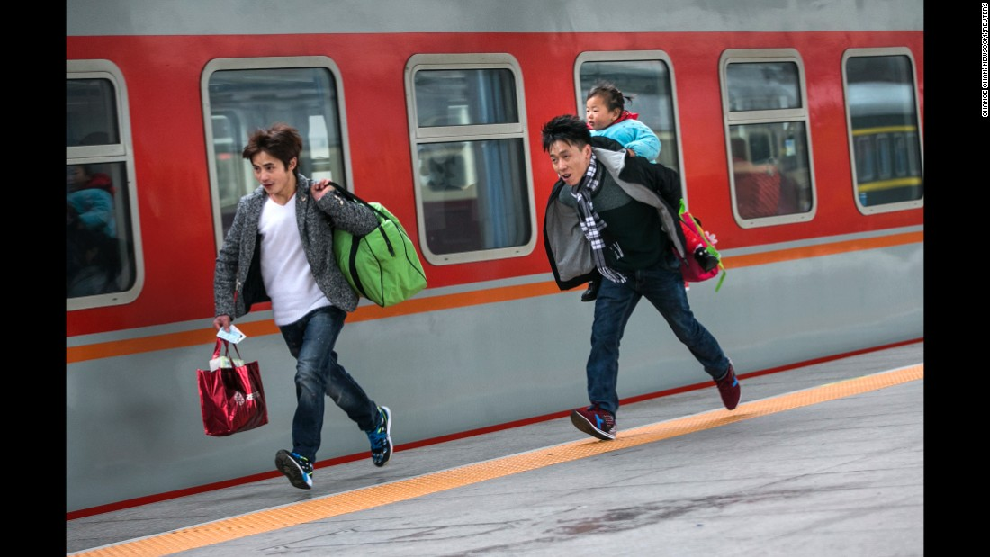 "Travelers run to catch a train in Hangzhou, China, on Sunday, January 31. China's annual <a href=""http://www.cnn.com/2015/02/17/travel/china-spring-migration-chunyun/index.html"" target=""_blank"">Spring Festival migration</a> started on January 24. It's expected that 2.9 billion trips will be made during the holiday period this year."