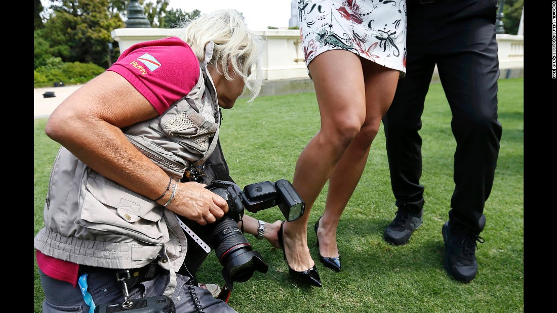 "A photographer helps Angelique Kerber after the tennis champion's shoe got stuck during her visit to the Government House in Melbourne on Sunday, January 31. A day earlier, <a href=""http://www.cnn.com/2016/01/30/tennis/australian-open-tennis-serena-williams-angelique-kerber/"" target=""_blank"">Kerber defeated Serena Williams </a>to win the Australian Open."