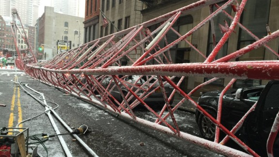 The New York City Fire Department dispatched 33 units with 138 personnel to the scene at 40 Worth Street and West Broadway after the crane collapsed shortly before 8:30 a.m.
