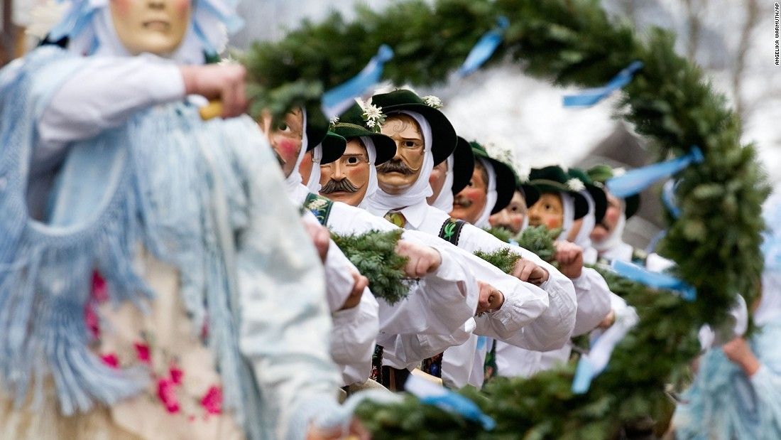 Revelers in traditional costumes celebrate during a Carnival parade in Mittenwald, Germany, on Thursday, February 4.