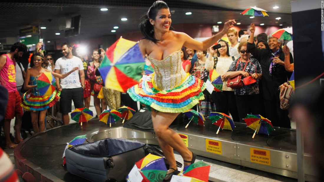 Carnival dancers perform at the baggage claim area at an airport in Recife, Brazil, on February 4.