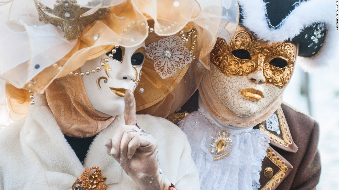 Revelers pose in St. Mark's Square in Venice, Italy, during Carnival celebrations on February 4.