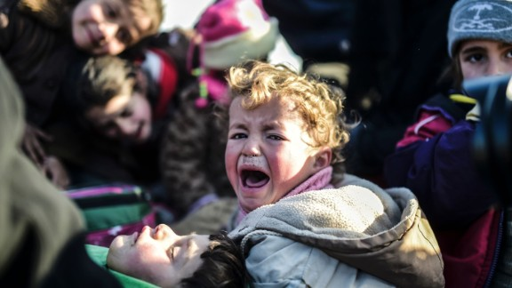 A Syrian child cries as residents flee the northern embattled city of Aleppo on February 5.
