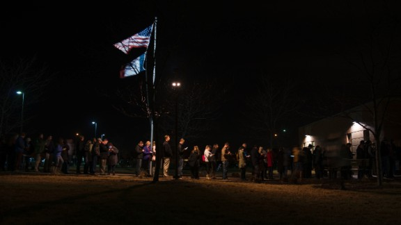 Iowa caucusgoers line up outside a Democratic meeting held at Maple Grove Elementary in West Des Moines on Monday, February 1. Former Secretary of State Hillary Clinton and Vermont Sen. Bernie Sanders were deadlocked at 50% after 99% of votes had been counted, but Clinton emerged victorious early the following morning.