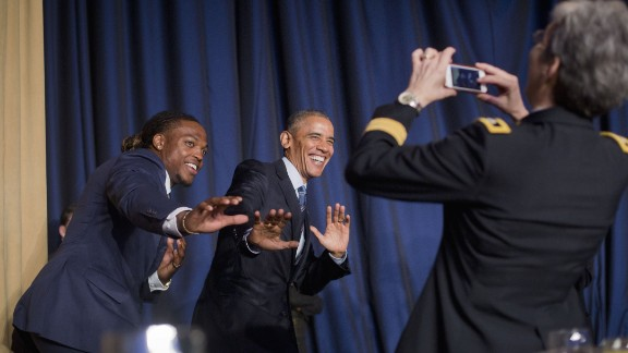 """University of Alabama football player and Heisman Trophy winner Derrick Henry and President Barack Obama strike a """"Heisman pose"""" during the National Prayer Breakfast in Washington on Thursday, February 4. The annual event brings together U.S. and international leaders and figures from different parties and religions for an hour devoted to faith."""