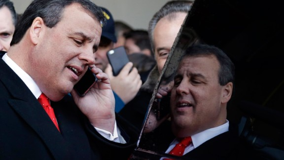 Republican presidential candidate New Jersey Gov. Chris Christie is reflected in his car's window after a campaign event on February 6, in Bedford, New Hampshire.