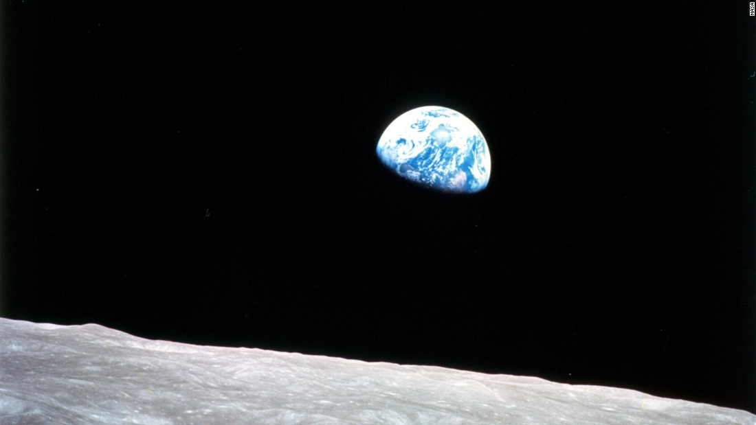 "Apollo 8 launched on December 21, 1968, and entered lunar orbit on Christmas Eve. That night, the crew held a live broadcast and showed pictures of the Earth from their spacecraft. ""The vast loneliness is awe-inspiring and it makes you realize just what you have back there on Earth,"" Lovell said. They ended the broadcast taking turns reading from the Book of Genesis."