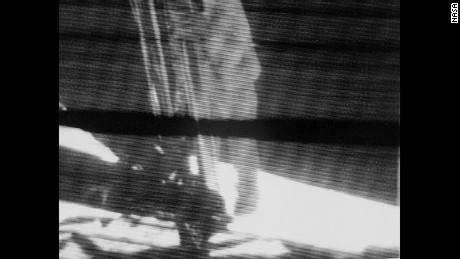 This well-known angle shows Neil Armstrong's first step on the moon. A new film has a different view.
