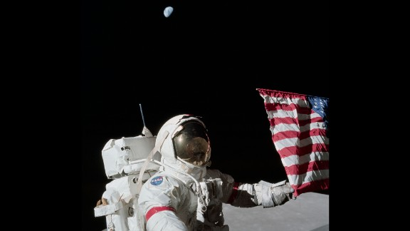 """Cernan holds a corner of the American flag during the first Apollo 17 moonwalk. Cernan, the last man on the moon, had these parting words as he left: """"We leave as we came and, God willing, as we shall return -- with peace, and hope for all mankind."""""""