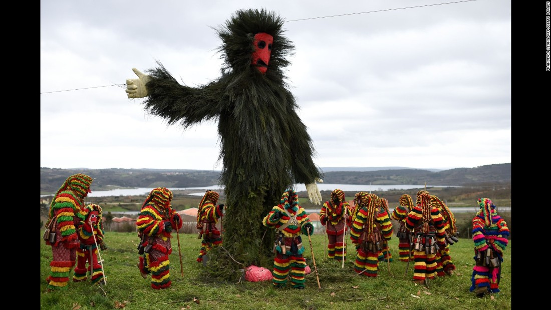 Costumed revelers gather around a giant effigy during Carnival celebrations in Podence, Portugal, on Sunday, February 7.