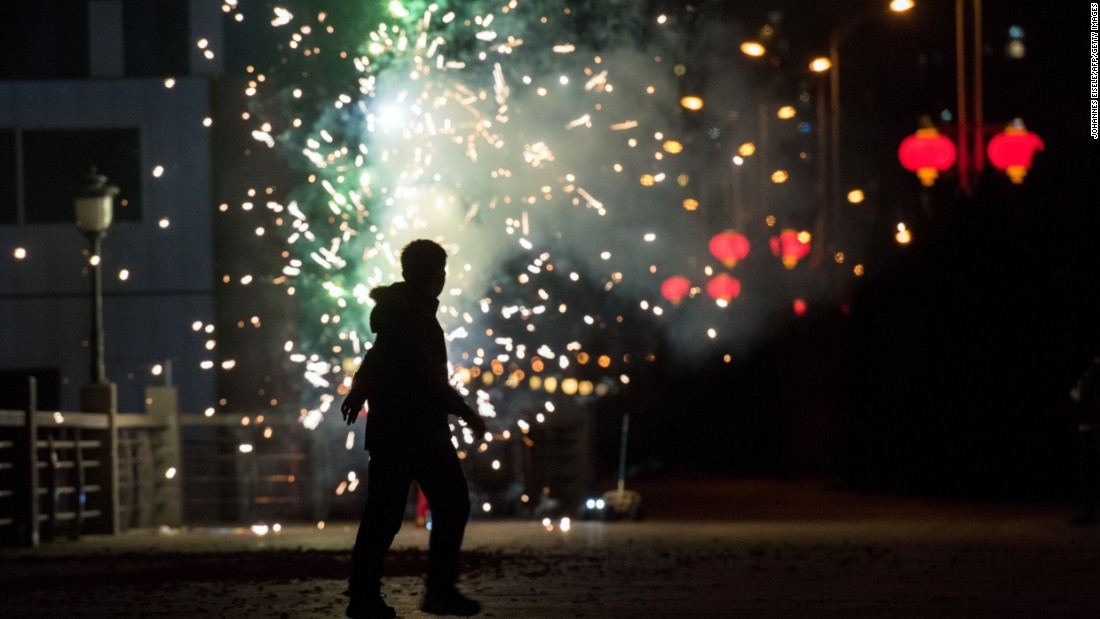 A man sets off fireworks near the Yalu River in Dandong, China, on February 7.