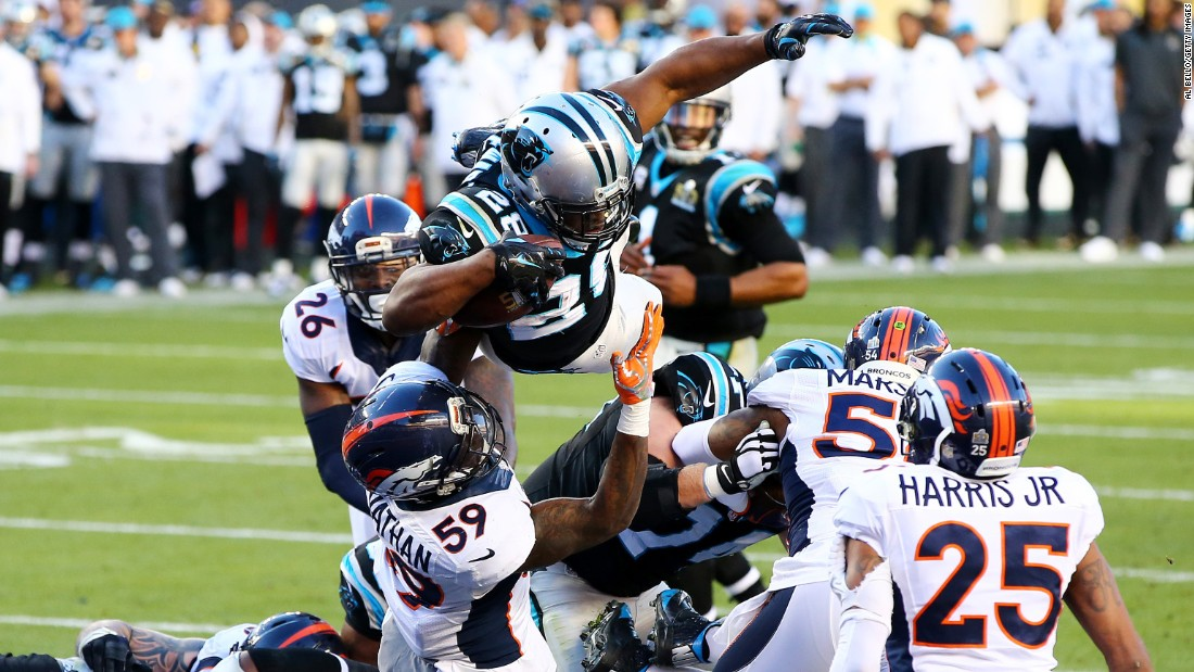 Jonathan Stewart leaps into the end zone, scoring a second-quarter touchdown for the Panthers.