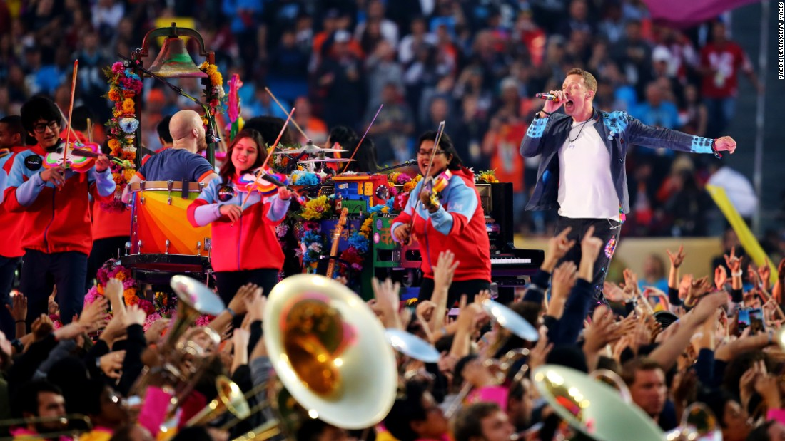 Coldplay kicks off the halftime show with help from some young musicians.