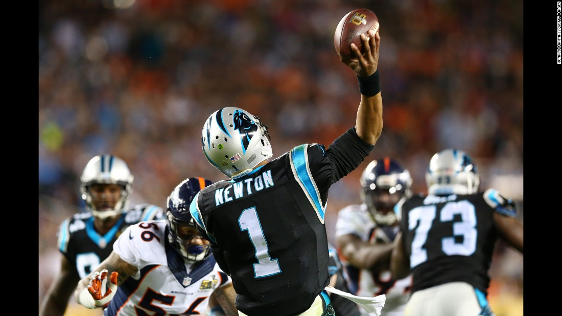 Newton passes the ball in the third quarter.