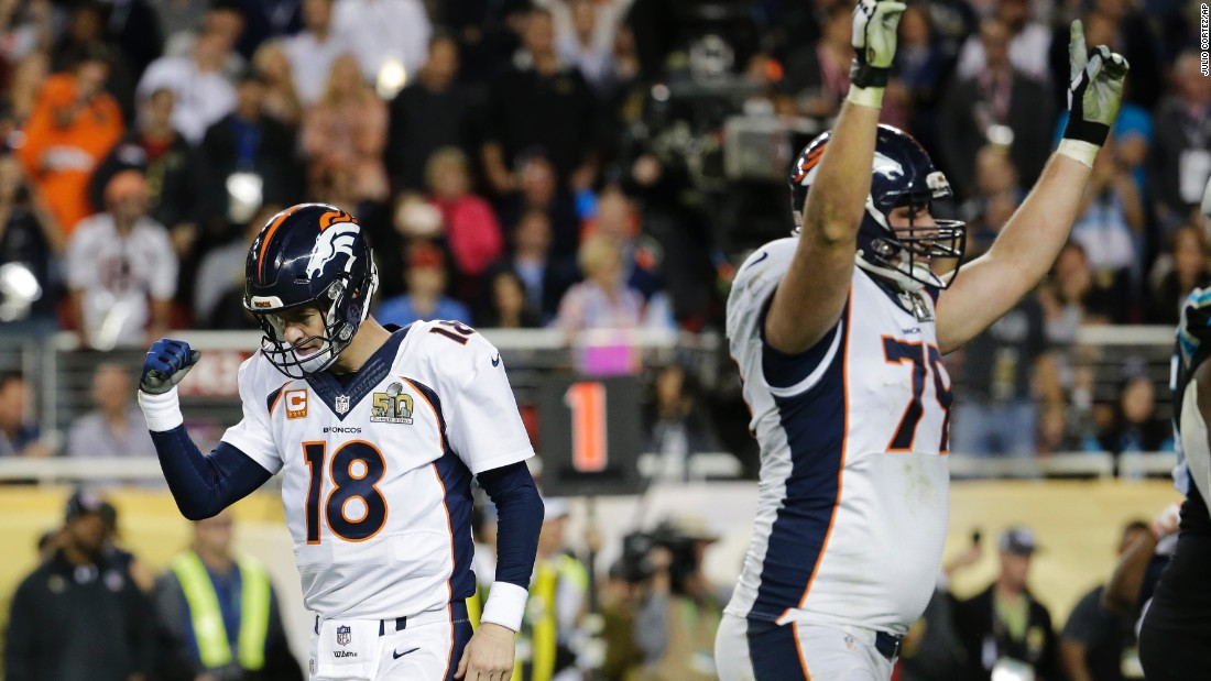 Manning and teammate Michael Schofield celebrate C.J. Anderson's touchdown in the second half.