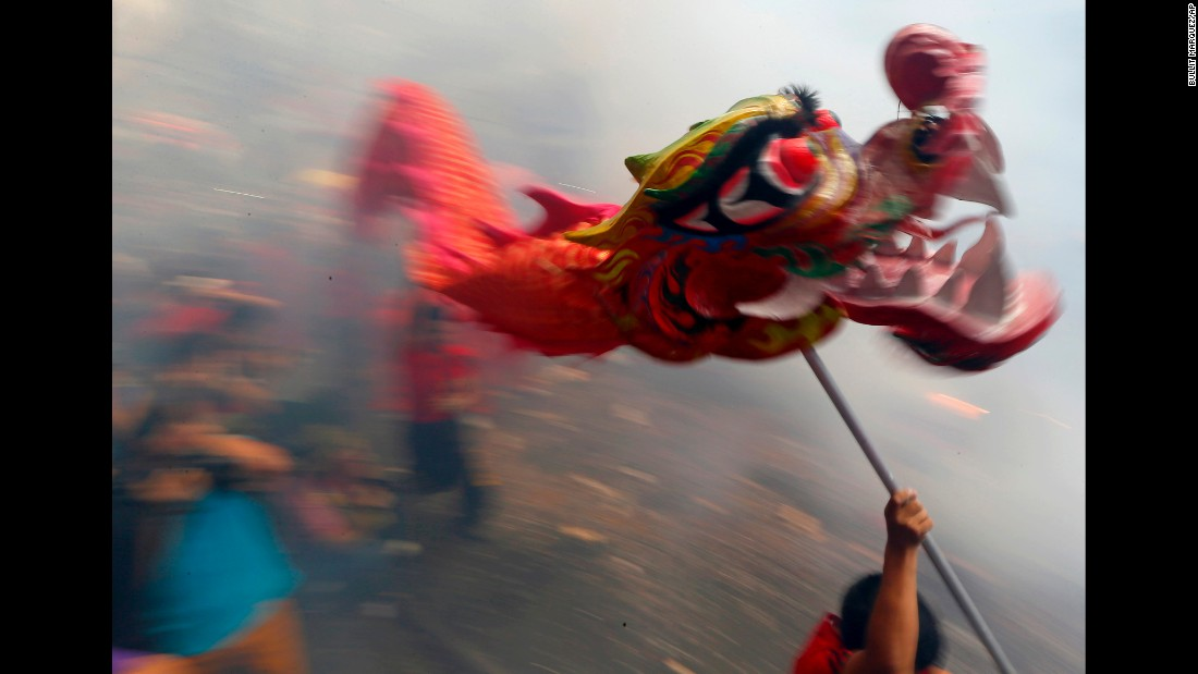 Dancers perform amid exploding firecrackers in Manila, Philippines, on February 8.