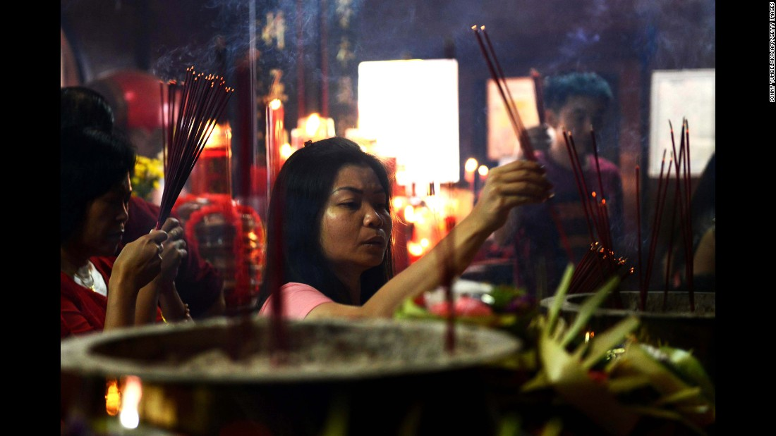 A woman offers prayers at the Vihara Dharmayana Temple in Kuta, Indonesia, on February 8.